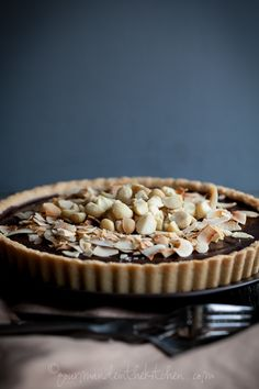 Chocolate, coconut, macadamia nut tart (gluten-free, vegan) (Find gluten free desserts recipes at www.glutenfreedesserts.info )
