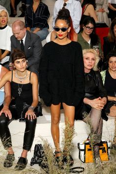 Zoe Kravitz wears a black sweater dress with black wedges and cat-eye sunglasses with Langley Fox and Debbie Harry