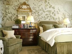 Richard Mervis: Custom de Gournay wallpaper gives the master bedroom a light, airy feel. An Empire mahogany chest of drawers provides ample storage space. The upholstered velvet headboard and bed skirt are custom.