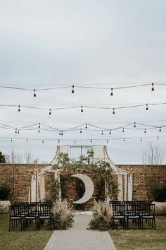 Modern, celestial-themed wedding ceremony - outdoor ceremony with moon backdrop and greenery - Find a wedding venue in your city on WeddingWire! {Terrain Gardens}