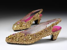 Pair of evening shoes  Place of origin: Paris, France (made)  Date: 1952-1954 (made)  Artist/Maker: Dior, born 1905 - died 1957 (designer)  Materials and Techniques: Silk satin covered with applied gold braid, sequins, and paste