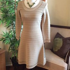 Karl Lagerfeld Gold Dress NEW Designergorgeous gold Karl Lagerfeld dress. Blend of rayon, nylon and lurex never worn. A lined, pull over, stretch material. Beautiful treatment at hem, neck and sleeves. Karl Lagerfeld Dresses