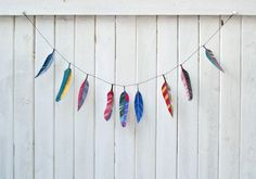 Illustrated paper feather garland on Etsy.