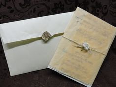 DIY Invitations:  Bought cheap Wal-Mart envelopes. Used a personalized envelope seal with our last name initial. We did this for every invitation: Takes a long time, but it comes out beautiful. Used peach tissue paper for the wrap around the invitation paper, twine for the rope, and then a fake flower tied in it.