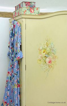 1940s Housecoat and old French fabric boxes with antique hand painted floral wardrobe.