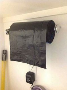 Trash bags hanging on curtain rod in garage