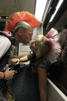 Punk couple, probably not original punks, but sporting matching mohawks.