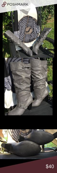 """👢NWOT Gray Pull-on Boots 👢 Slouch pull-on faux leather gray boots with buckle accents. Have never been worn. They are approx. 19"""" tall with a calf opening of 17"""". There is the usual stretch area to fit larger calfs. It can stretch to approx. 18"""". The heel is 3.5"""" tall. Great boots for leggings, tucked in jeans or even dresses. I like the pull-on because there is no zipper to distract from its beauty!! Rampage Shoes Heeled Boots"""