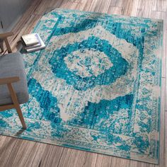 Sydney Blue Area Rug is a bright and trendy collection with both modern geometric and updated traditional patterns. Soft, warm, neutral tones are accented with bright, cool, blues and warm reds and yellows. Faded designs add that extra something and a plush pile of air twist frieze polypropylene gives an exceptional textured look. This yarn is soft, stain resistant and doesn't shed or fade.