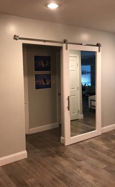 A modern take on a traditional idea, this mirrored sliding door will give your room that contemporary rustic feel it needs. This door is also available to be hung with hinges (not included). Basement Renovations, Home Renovation, Home Remodeling, Basement Ideas, Basement Decorating, Closet Bedroom, Diy Bedroom, Bedroom Ideas, Interior Barn Doors
