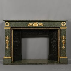An Empire style gilt-bronze mounted green granite fireplace. French, Circa 1850.[Ref: B65670]For more information and additional images please visit our website: www.adrianalan.com