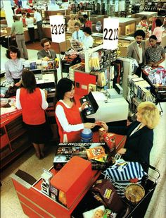 Awesome, AWESOME shot of a department store checkout area, 1970s! Check out the Atari VCS (2600) and Home Run game cartridge she's buying!
