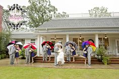 Bridal party portrait in the rain. Classic Southern Fall Wedding. Rainy day wedding. Rain wedding. Photography:  Andie Freeman Photography, www.TheAthensWeddingPhotographer.com Wedding Coordinating:  Wild Flower Event Services Venue and Floral:  The Thompson House and Gardens, Bogart, GA  Entertainment:  Dynamite Entertainment Make-up:  Bombshell Creations www.BombshellCreations.com