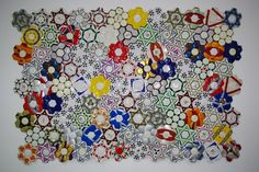 Stone Flower by Felipe Barbosa.  Here's a Brazilian artist making what looks like traditional American hexagonal quilts out of soccer balls.
