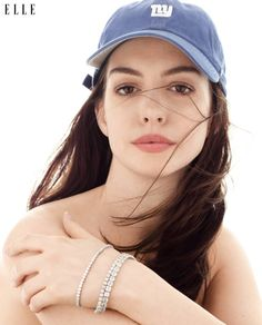 Anne Hathaway wears Bulgari bracelets, Chopard bracelet and '47 baseball cap