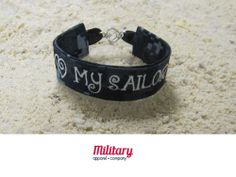 """Do you love Military pride bracelets? Want to wear your US Navy colors proudly? Our patriotic US Navy bracelet is the perfect item for you! It's adorable heart-shaped clasp shows the love you have for your American Hero! Handcrafted in the USA from genuine NWU fabric. Don't forget one for your best friend!   5/8""""x7"""" (bracelet part, clasp not included in measurements).  If you desire a different camo or different embroidery, contact us and we will design a custom bracelet just for you!"""