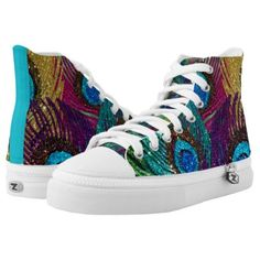 A rainbow of peacock feathers against a green background.  The design sparkles to life with these high tops shoes.