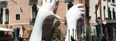 MONUMENTAL HANDS RISE FROM THE WATER IN VENICE TO HIGHLIGHT CLIMATE CHANGE
