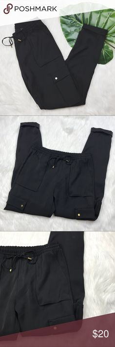 """H&M Black Polyester Cargo Joggers Very gently used (like new) H&M black polyester cargo style joggers in women's size 6.   Measurements  Length: 37.5""""  Inseam: 28"""" Waist Across: 14"""" Leg Opening: 5"""" Rise: 10.5"""" H&M Pants Track Pants & Joggers"""