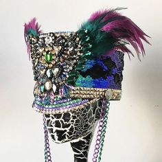 Phoenix Marching band hat in green/purple/gold -ready to ship in size 7 3/8 -available in other colors -made with reversible sequins -customizable (trim, reversible sequin, chains, etc.) -comes with a hard carrying case   Payment plans available.  Dont see anything that you like? Custom-made hats and headpieces available. Send a private message or email me at whocareswhynot@ymail.com  More of my other works at Facebook: WhoCaresWhyNot Instagram: @whocares_whynot