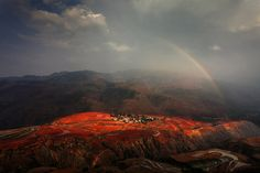 """""""Red Land: Sunset Cloud Village is one of the most picturesque places in Red Land, China. As its name indicates, it's best to see before sunset. The reddish brown soil turns redder after rainfall and after farmers plow the land"""". (Photo and comment by Peng Jiang/National Geographic Photo Contest via The Atlantic)"""