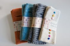"""""""wrist worms""""  cute name for fingerless mitts.  I like the little colored buttons!"""