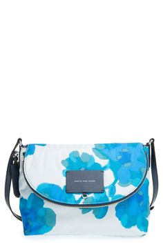 Crushing on the vibrant floral print of this Marc Jacobs crossbody bag.