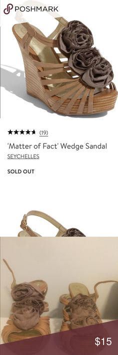 """Seychelles 'Matter Of Fact' 4"""" Wedge Rosette Shoe ✨✨ These are 71/2, but run 1/2 size small.  The reviews on Nordstrom also say the same thing.✨✨Swirls of raw-edge grosgrain ribbon fashion a row of deconstructed roses along the vamp of a stacked platform-wedge sandal. Adjustable ankle strap with buckle closure and inset elastic. Approx. heel height: 4"""" with 1"""" platform (comparable to a 3"""" heel). Leather upper with textile flowers/synthetic lining and sole. There are signs of wear in the…"""