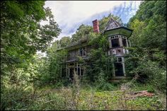 The House in the Woods    		A small abandoned Manor house in South Wales slowly being re-claimed  by nature after its occupants left.