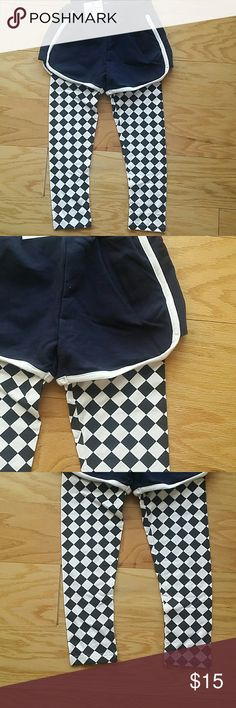 NWT Black Skort Adorable and very trendy skort. Shorts are in black and legging are in white and black  Very popular item  This item is brand new and never used.?? with tags. Bottoms Skorts