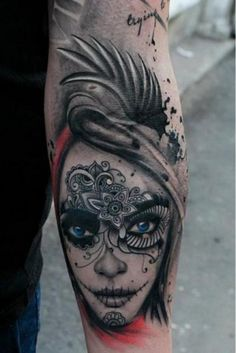 Day of the dead tattoo. The black and grey is ok. The blue in the eyes make this piece.