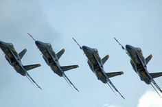 The Blue Angels make a photo pass at the Field of Flight & Balloon Fest in Battle Creek, MI last year (2011)