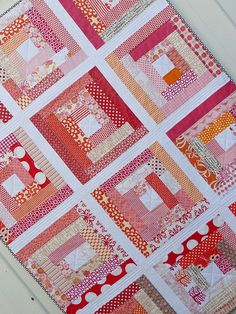 I absolutely love log cabin quilts! spotted this one on Red Pepper Quilts
