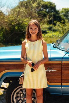 Where Do You Summer? Introducing the latest addition to our women's line, the classic shift dress. Whether you are wearing bold stripes or our signature hydrangea print, this silhouette is meant to come along on all your summer excursions for an effortlessly put together look. Color: Yellow, White Product Details: - 100% Cotton - Back Zip - Poly Liner - Machine Wash Cold - Made In the USA