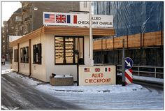 Checkpoint Charlie, Berlin, Germany - I went through the Autumn of 1985, before reunification.  There was a zig-zag 1/2 mile no-man's land between the sides of the wall.