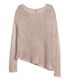 Chunky-knit sweater with a slight sheen. Dropped shoulders, long sleeves, and an asymmetrical hem.