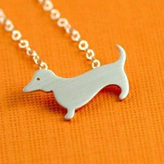 Dachshund Love Necklace in Silver. via Etsy.