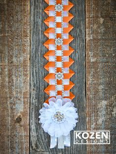 Homecoming Braid - Texas Champion braid with scallop ribbon and lace flower - MOST SCHOOL COLORS AVAILABLE  #homecoming #homecomingbraid #homcomingmum #homecominggarter #blingbraid #homecomingbraid #scallopribbon #fancyhomecomingbraid #mumsinc #kozenmumdesigns Texas Homecoming Mums, Football Homecoming, Homecoming Garter, Homecoming Ideas, Football Mums, Football Season, Ribbon Braids, Mums The Word, Money Lei