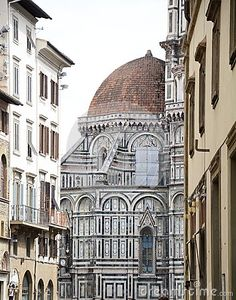 Lateral part of Duomo of Florence, shot between the antique buildings, Tuscany, Italy