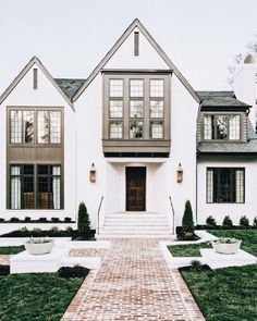 I love this exterior. The white brick, and the windows. How would it work with our window boxes?? #ClassicExteriorDesign #ExteriorDesignResidence #ExteriorDesignColor