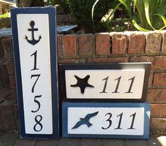 Signo de dirección número de la casa de playa casa del lago náutico por…
