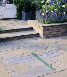Stonemarket Emperor Dragonfly feature patio paving circles for gardens are hand cut from natural sandstone and measure 1.7 metres in diameter. #PavingCircles #DecorativePavingCircles