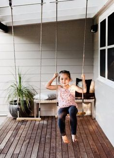 Swings on the front porch...love this idea.