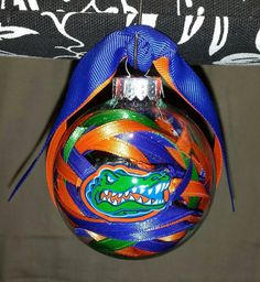 These ornaments are handmade. I can personalize one for you with a name, year, etc. They make great gifts for your childrens teachers, friends, Diy Christmas Ornaments, Glass Ornaments, Christmas Fun, Homemade Christmas, Christmas Bulbs, Xmas, Florida Gators Football, Gator Football, Navidad