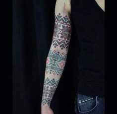 Beautiful cross-stitch tattoo sleeve :3