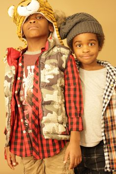 """Making the cold """"cool"""". Layer up with plaid and a fun hat."""