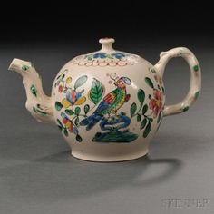 Staffordshire Enameled Salt-glazed Stoneware Teapot and Cover, England, c. 1765, globular shape with molded crabstock handle and spout, polychrome decorated on one side with a bird amongst flowers,