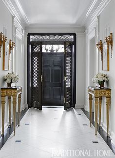All about architecture, the front door is backed by trellis French doors, making a dramatic entry. - Photo: Werner Straube / Design: Gail Plechaty