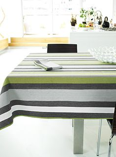 Designed in our studios exclusively for Simons Maison Definitively modern tablecloth with large masculine grey stripes on pure fashion green. High-quality polyester Easy-care, machine washable Matching napkin also available