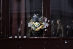 Flowers were placed in bullet holes at Le Carillon restaurant.